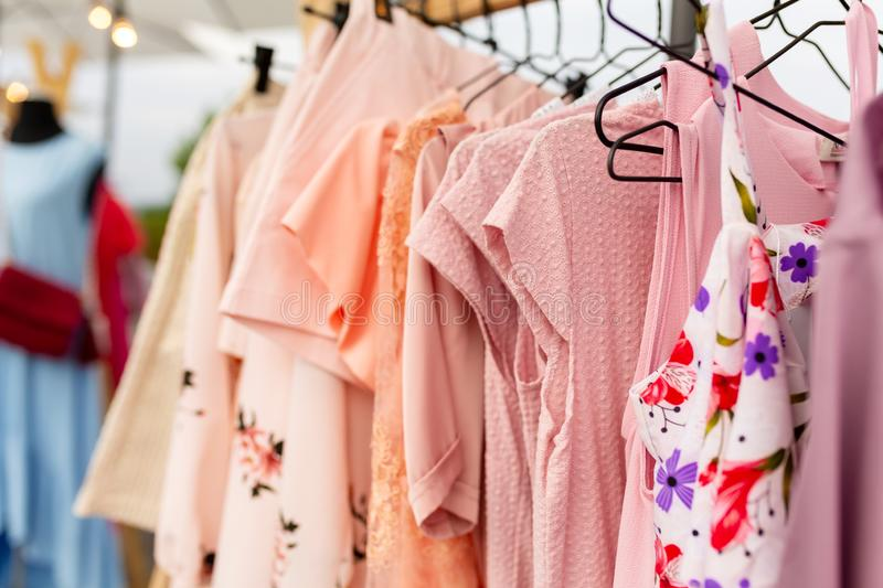 Racks with clothes outdoors. Designer sells clothes at a city fair.  royalty free stock images
