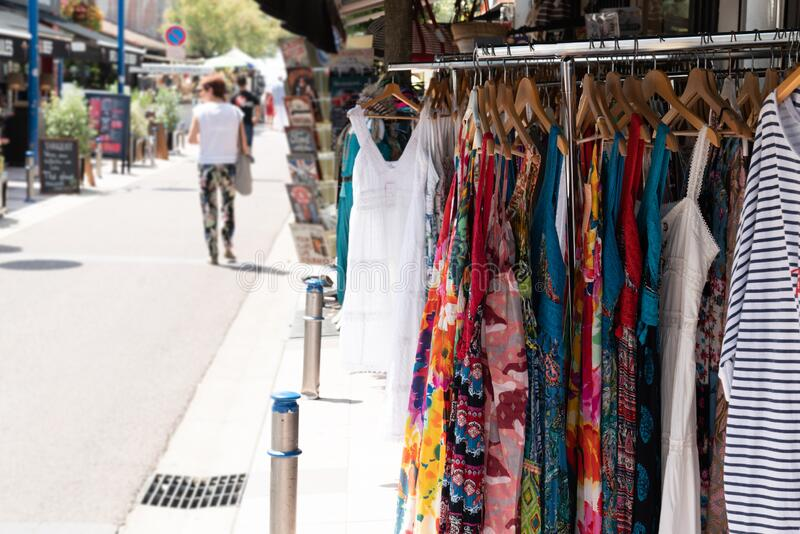 Racks with clothes street shop outdoors store sells clothes in city. A Racks with clothes street shop outdoors store sells clothes in city royalty free stock photo