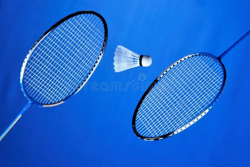 Racquets and a flying shuttlecock for badminton. Players rivals summer recreation, spectacular and affordable, is an Olympic sport. That develops agility, speed stock photography