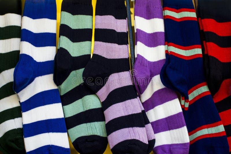 Rad av färgglade rugbysportsockor royaltyfria foton