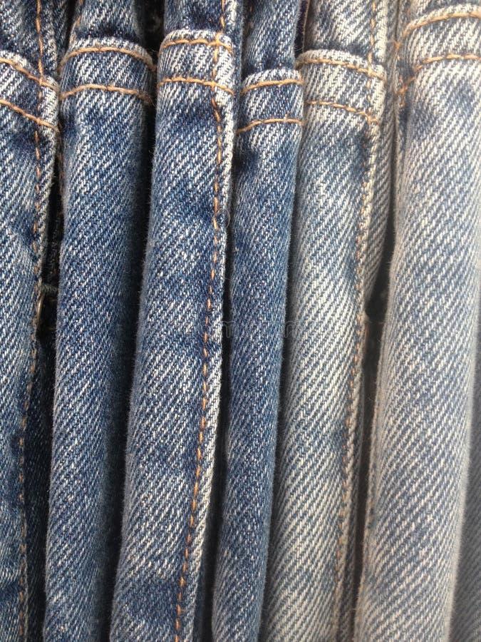Rad av jeans royaltyfri bild
