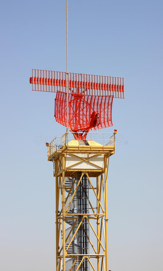 Radar. A radar tower isolated on a blue sky background royalty free stock photo