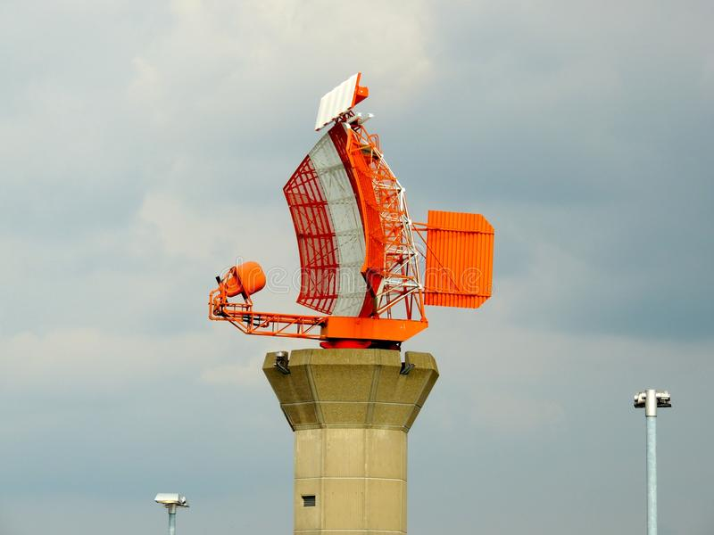Radar at London heathrow airport. Large orange static radar installation near heathrow airport Terminal 3. This radar looks west and monitors aircraft royalty free stock photography