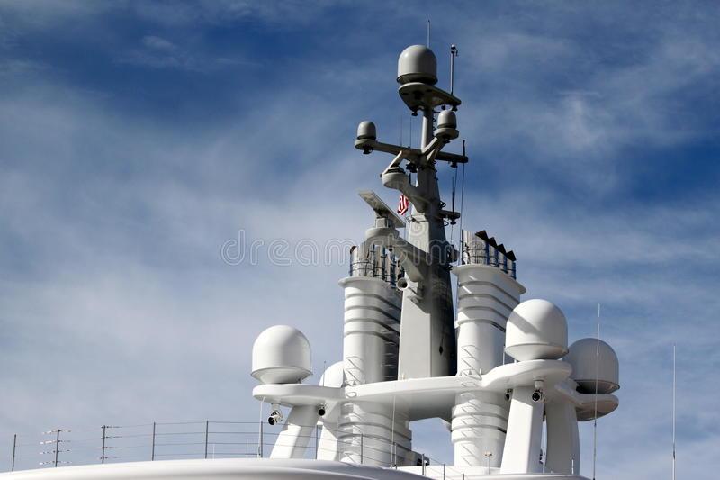 Radar. System on to of a ship with blue cloudy sky in the background stock photo