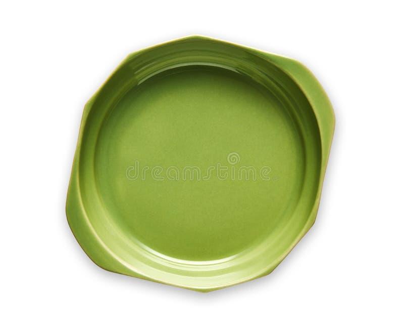 Raddoppi il piatto trattato, i piatti verdi vuoti della ceramica, vista da sopra isolato su fondo bianco con il percorso di ritag immagine stock