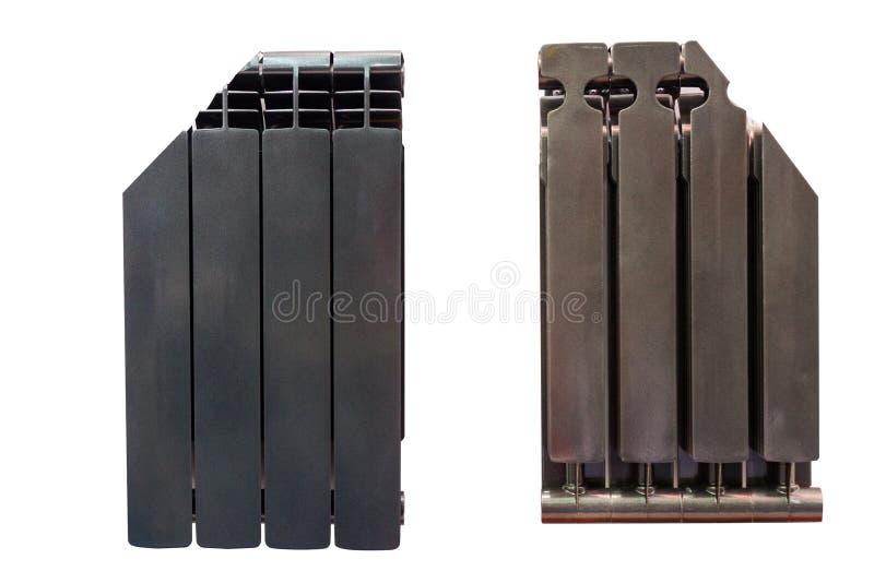 Radiadores negros de la calefacción aislados en un fondo blanco incluyendo la trayectoria de recortes fotografía de archivo libre de regalías
