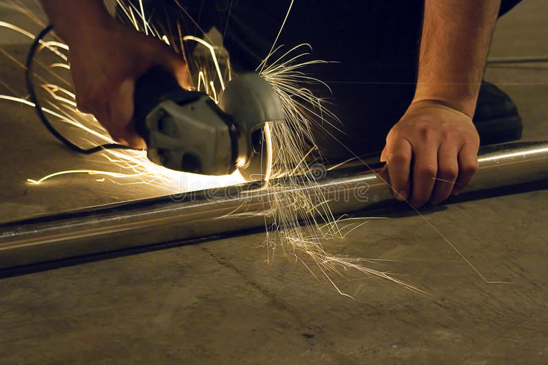 Radial arm saw. Working casting a stream of sparks royalty free stock images