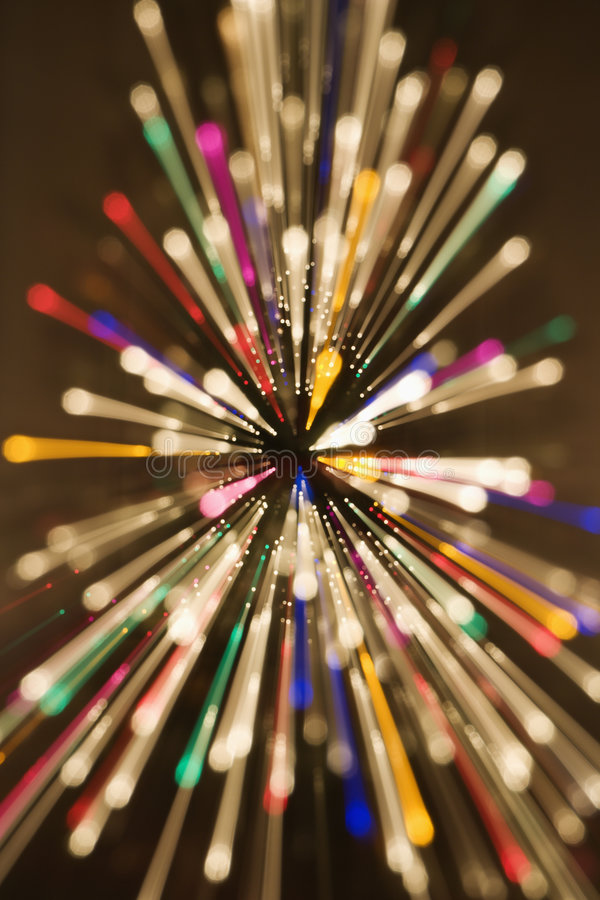 Radial blurred lights. Abstract Christmas tree with motion blurred multicolored lights in radial starburst pattern royalty free stock images