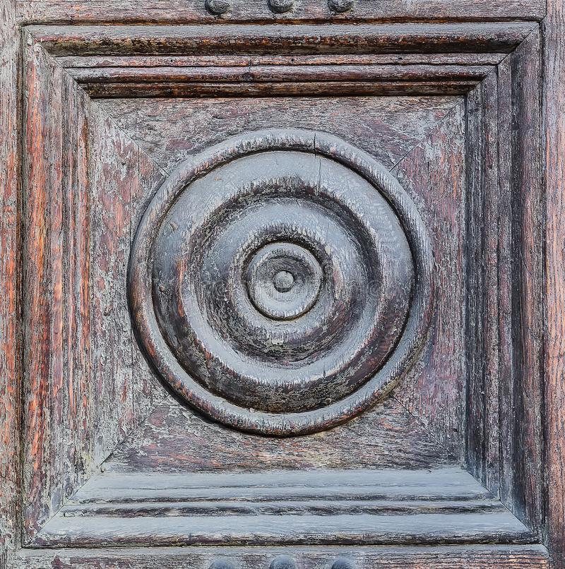 radial decor on old wooden door royalty free stock photo