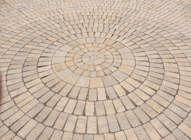 Radial paving stone pattern. An angled view of a circular or radial paving stone pattern stock photos