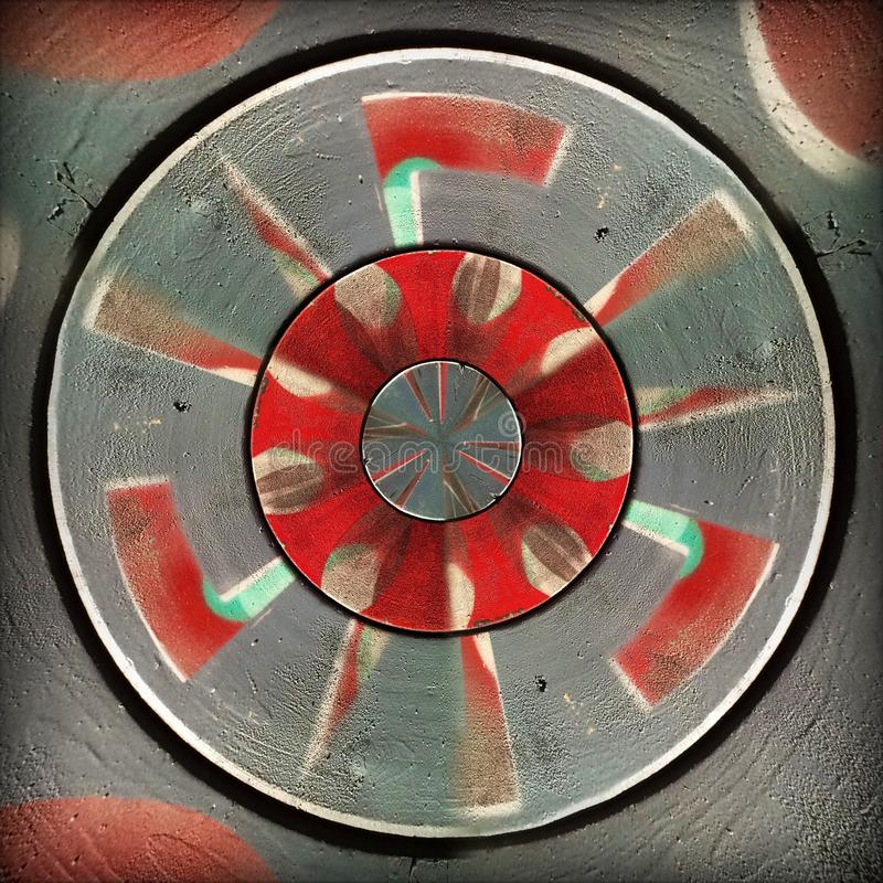 Radial red gray circular abstract pattern. Radial red and gray painted circular abstract pattern royalty free stock images