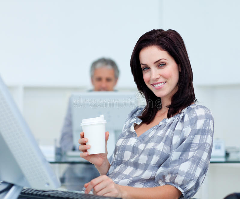 Radiant Businesswoman Holding A Drinking Cup Stock Photography