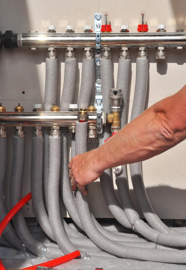 Radiant Floor Heating Installation Heating System. Man install underfloor water heating floor construction. royalty free stock photography