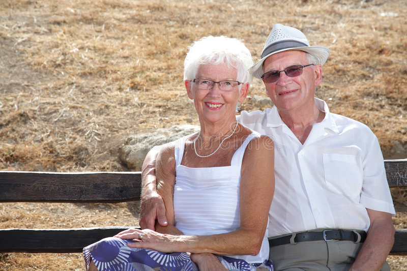 Radiant senior couple. Beautiful senior couple relaxing outdoors on a sunny day stock photos
