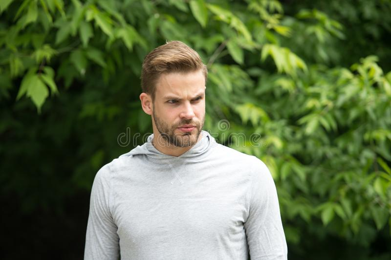He radiates confidence. Man with beard looks handsome perfect hairstyling. Guy bearded attractive style appearance. Man. Bristle strict face stylish hairstyle royalty free stock image