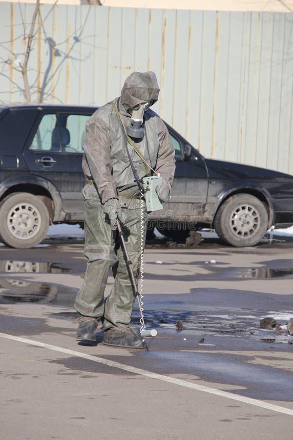 Radiation exposure. Man in radiation protection suit measures radiation stock photos