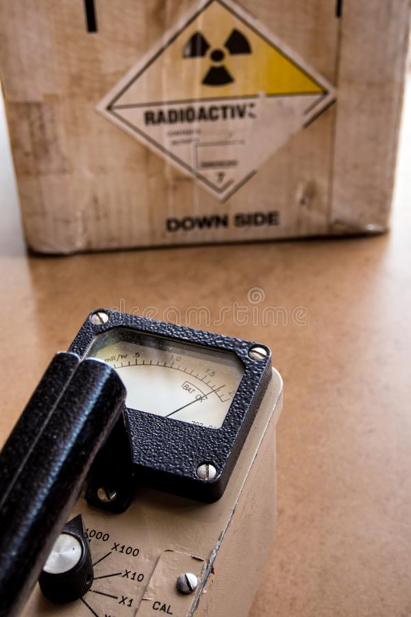 Radiation measuring with radiation survey meter royalty free stock photo