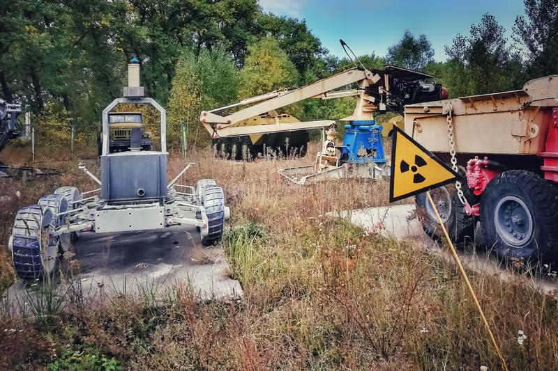 A radiation sign warns of the radioactive vehicles used by the liquidators of the Chernobyl desaster, Ukraine. A radiation sign warns of the radioactive royalty free stock photography