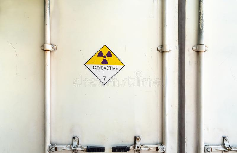 Radiation warning sign on the Dangerous goods transport label Class 7 at the container of transport truck. Radiation warning sign on the Hazardous materials stock photography