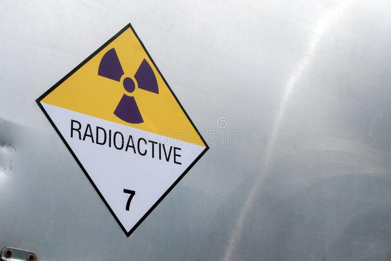 Radiation warning sign on the Dangerous goods transport label Class 7 at the container of transport truck. Radiation warning sign on the Hazardous materials royalty free stock photography