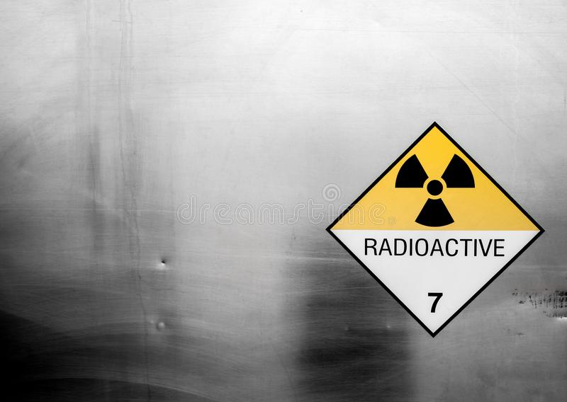 Radiation warning sign on the Dangerous goods transport label Class 7 at the container of transport truck royalty free stock image