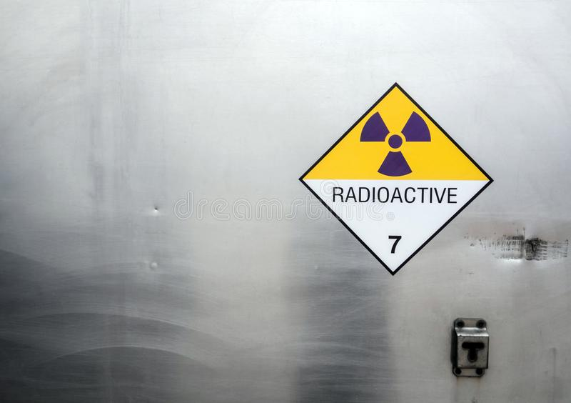 Radiation warning sign on the Dangerous goods transport label Class 7 at the container of transport truck. Radiation warning sign on the Hazardous materials stock photos