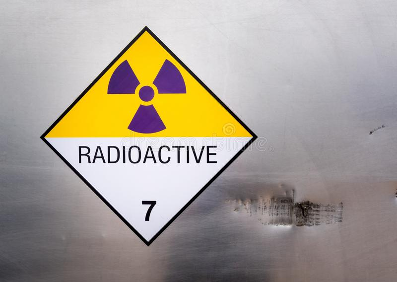 Radiation warning sign on the Dangerous goods transport label Class 7 at the container of transport truck. Radiation warning sign on the Hazardous materials stock photo