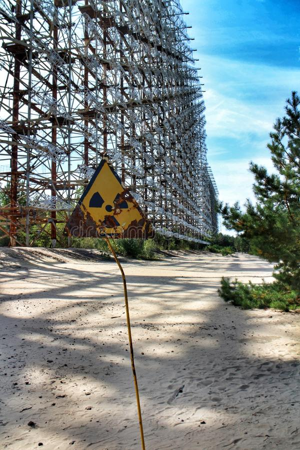 Radiation warning sign in front of the Duga-1 radar near Pripyat, Chernobyl exclusion zone, Ukraine royalty free stock photos