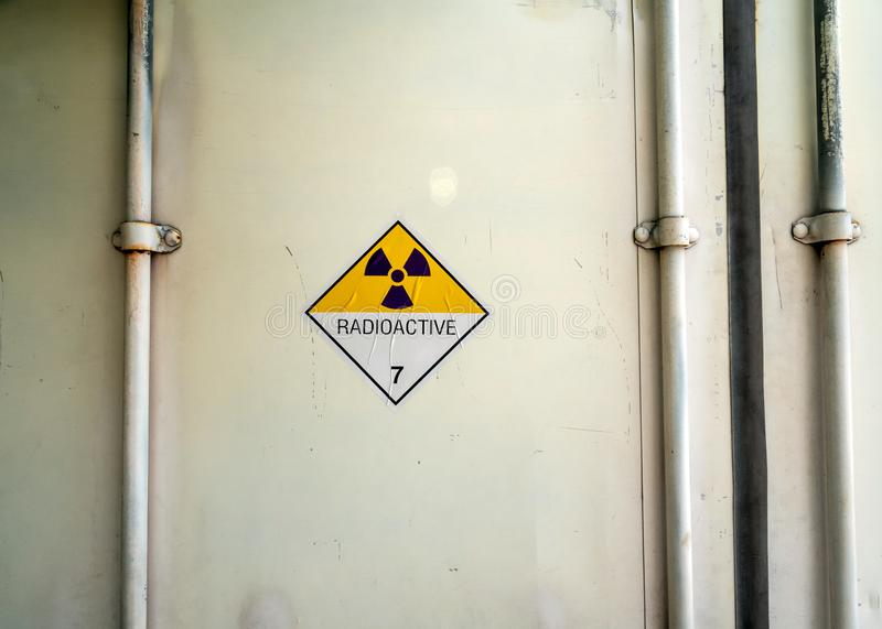 Radiation warning sign on the Dangerous goods transport label Class 7 at the container of transport truck. Radiation warning sign on the Hazardous materials royalty free stock images