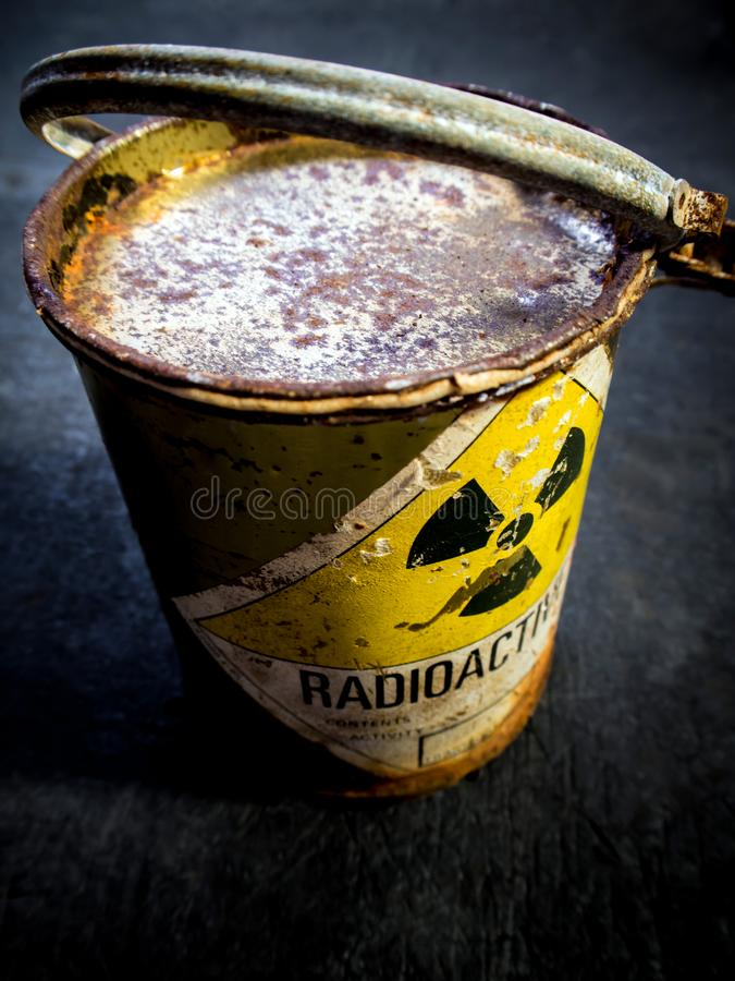 Radiation warning sign on the rusty and decay radioactive material container. Radiation warning sign on transport index label stick on the rust and decay stock photos