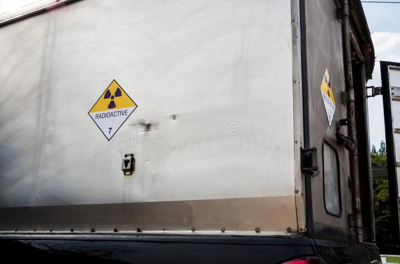 Radiation warning sign transport label Class 7 on the Dangerous goods package type A in the container of transport truck. Radiation warning sign on the Hazardous royalty free stock images