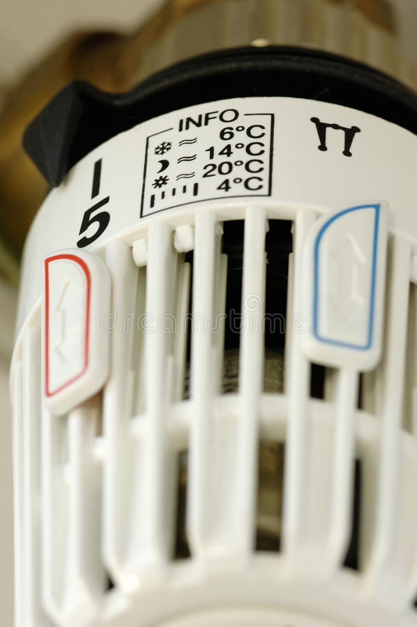 Radiator control with degree-info stock image