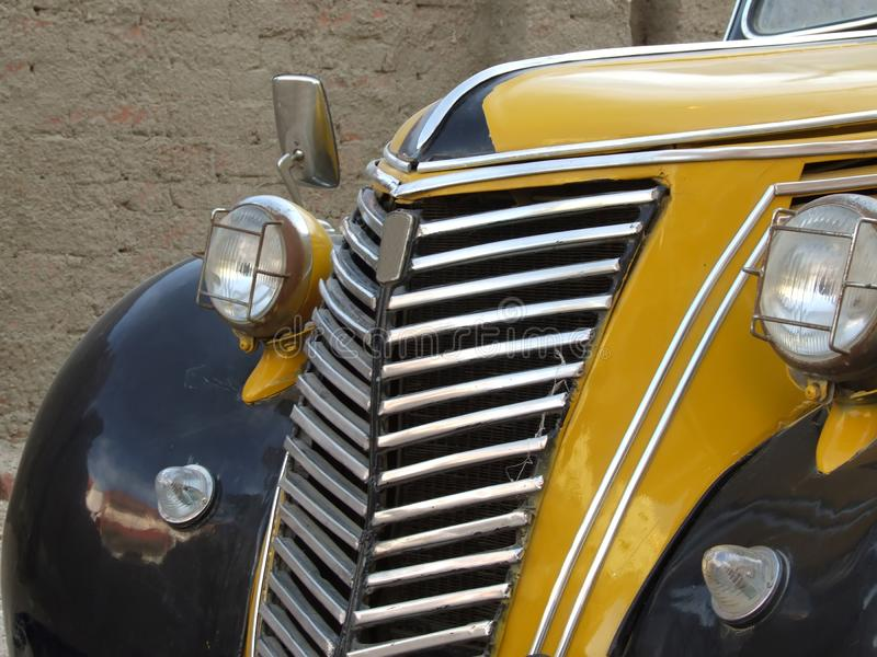 Radiator of old yellow car stock photo