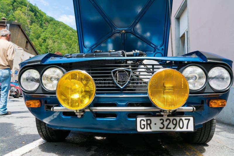 Radiator and yellow rallye headlights of an old timer blue Lancia sportscar stock photo