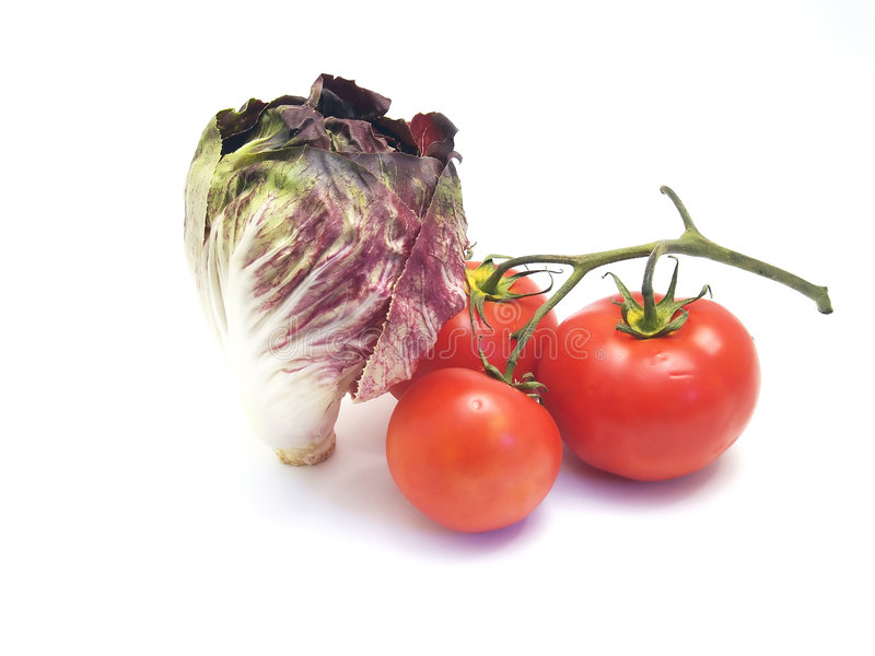 Radiccio y tomates imagen de archivo libre de regalías