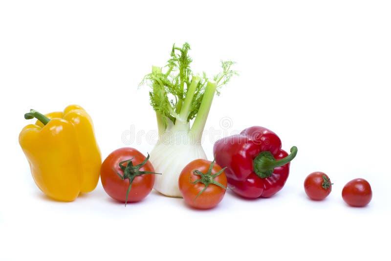 Radice di prezzemolo di peperone con pepe ed i pomodori gialli sopra fotografia stock libera da diritti