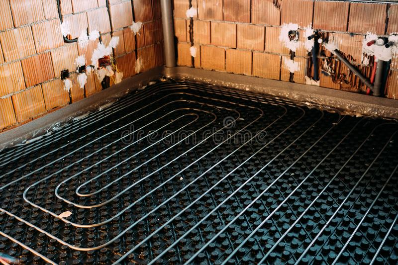 Radient Floor construction installation by plumber. Radient Floor construction heating installation royalty free stock photos