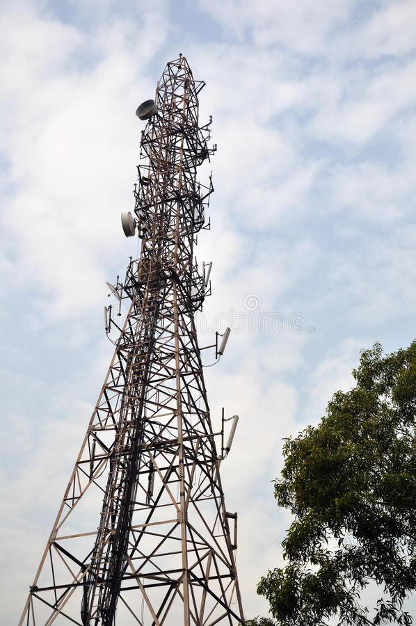 Radio antenna tower. High metall radio antenna tower against blue sky stock photography