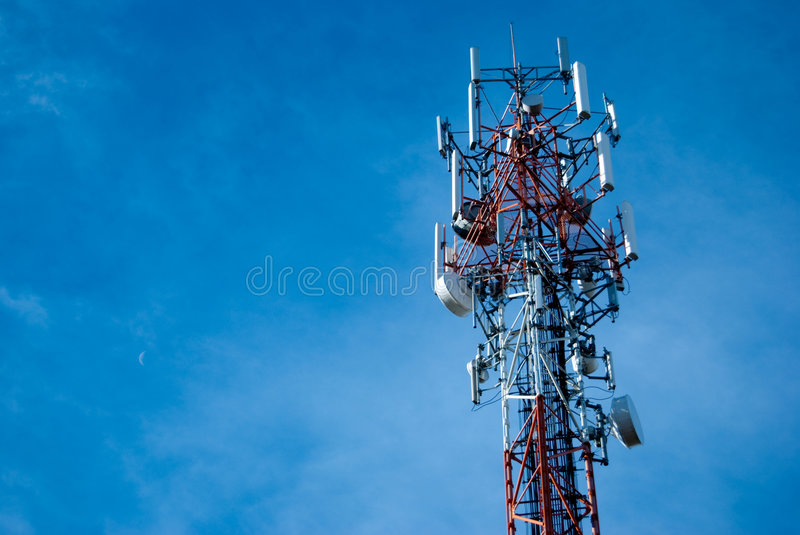 Radio antenna tower. Large radio antenna tower against a blue sky stock images