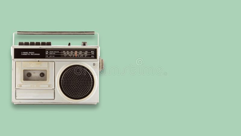 Radio cassette recorder and player on color background. Retro technology. flat lay, top view hero header. vintage color styles stock image