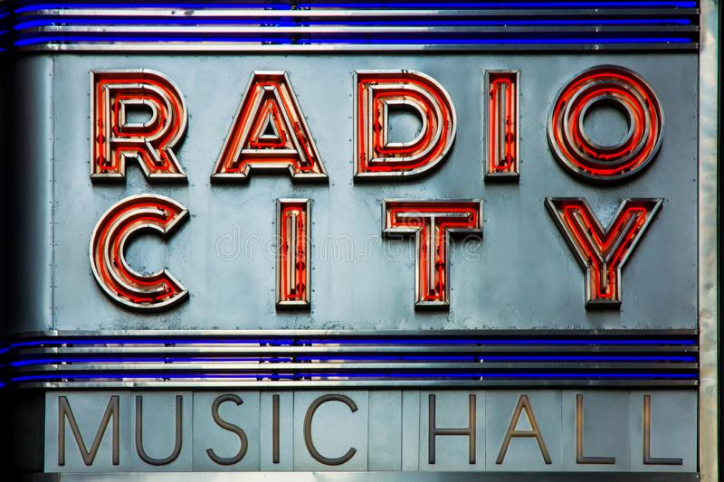 Radio City Music Hall facade neon lettering in New York, a famous entertainment venue located in within Rockefeller Center royalty free stock image