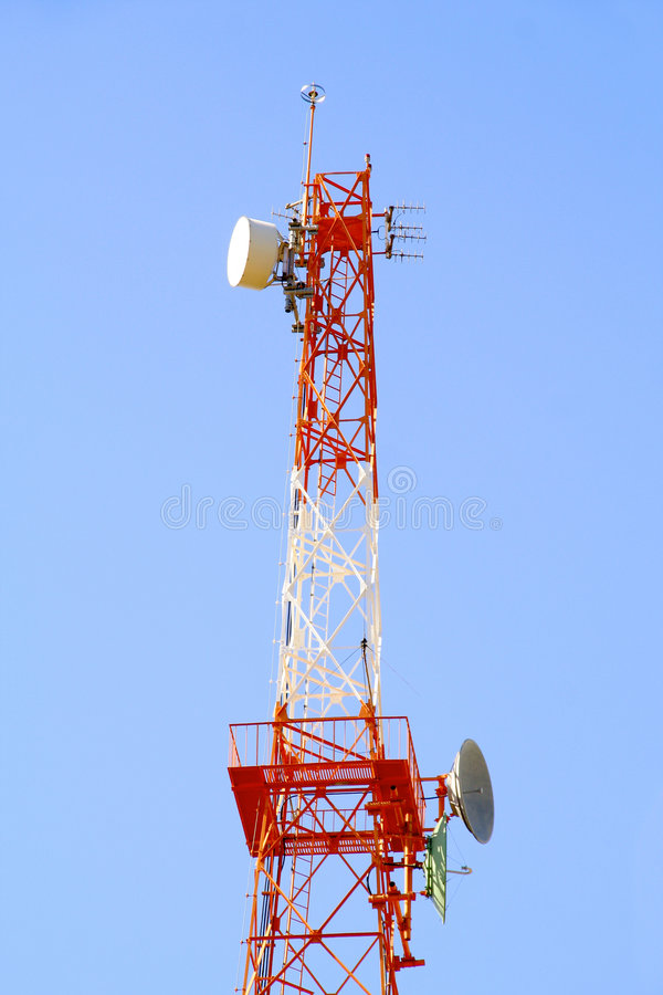 Radio communications antenna. Over a clean blue sky stock photo
