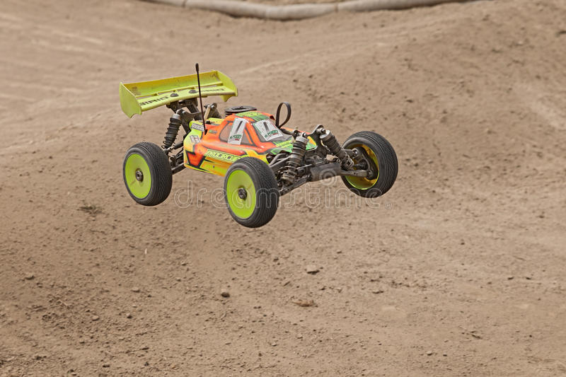 Radio controlled buggy. Car model, internal combustion engine, in regional championship scale 1/8 off road in dirt track Il Pozzo on April 26, 2015 in Riolo stock images