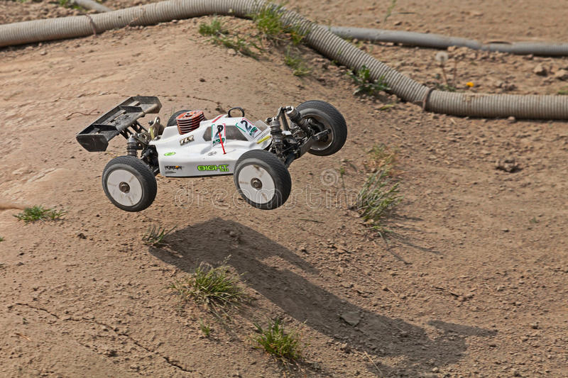 Radio controlled buggy. Car model, internal combustion engine, in regional championship scale 1/8 off road in dirt track Il Pozzo on April 26, 2015 in Riolo stock photos