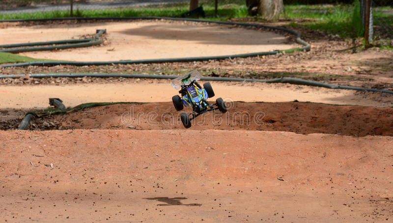 Radio controlled buggy car model in race. Sydney, Australia - November 30, 2014. Radio controlled buggy car model in race, internal combustion engine on a bumpy stock image