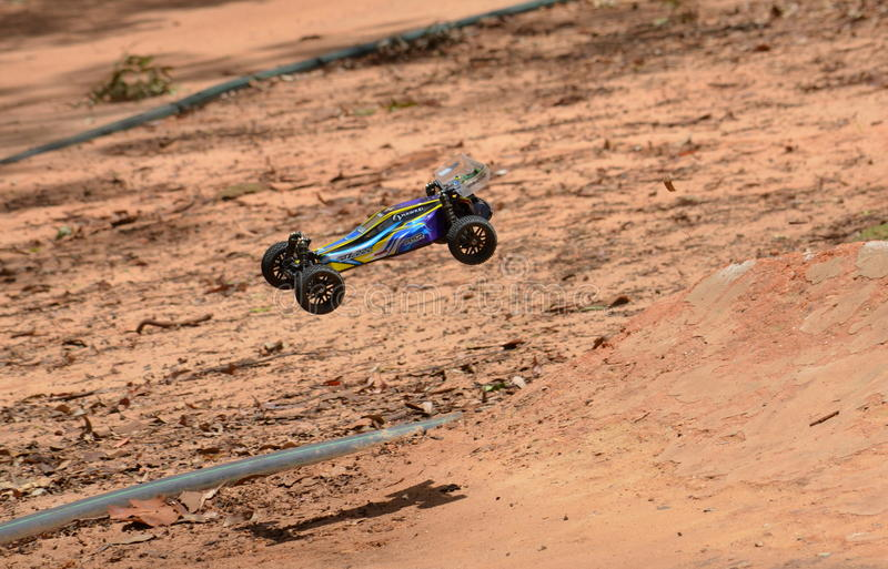 Radio controlled buggy car model in race. Sydney, Australia - November 30, 2014. Radio controlled buggy car model in race, internal combustion engine on a bumpy stock photography