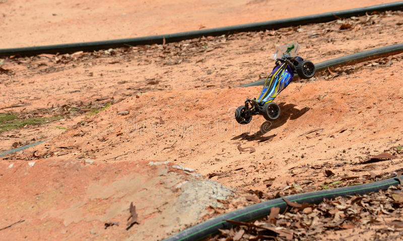Radio controlled buggy car model in race. Sydney, Australia - November 30, 2014. Radio controlled buggy car model in race, internal combustion engine on a bumpy royalty free stock photography