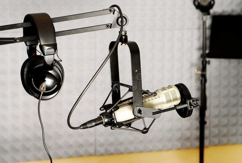 Radio DJ equipment. Tools of the radio industry, a DJ headset and microphone, inside a sound studio