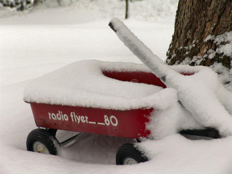 Radio Flyer. Old radio flyer wagon covered in snow stock images
