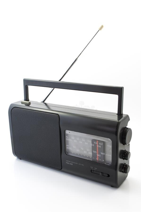 Radio AM FM. Portable black Radio on a white background royalty free stock photos